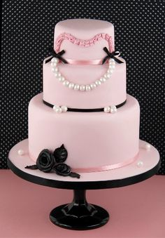...pink looks like a breakfast at tiffanys cake. beautiful or chanel inspired cake