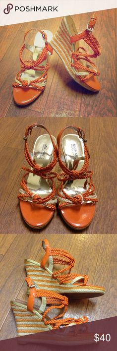 Michael Kors braided wedges Orange and natural color braided strappy wedge sandals. Buckles at ankle, heel height 3.5 inches with a .5 inch platform. Minor wear MICHAEL Michael Kors Shoes
