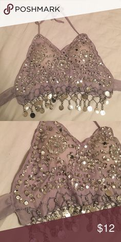 Beaded festival halter top Handmade beaded festival halter top. Perfect for any music festival or rave. Brand new, never worn before. Adjustable both at the top and in the back. Tops Crop Tops