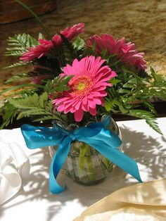 4 Gerber Daisies and Greens in an Ivy bowl with bow