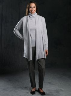 Our pure cashmere long shawl collar cardigan, exlusively designed for us in Scotland, where craftsmanship and quality go hand and hand with updated styling and sophisticated color. Pair it with our cashmere pullover for an understated, yet classic sweater set. Shown here in Potash, a mélange of soft grey, and available in sizes S-XL.