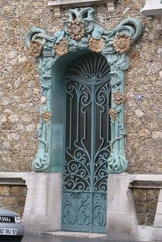 Beautiful Ironwork Painted Door and Ornate French Cultural Exterior