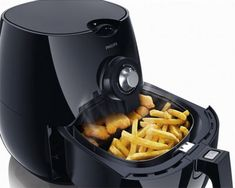 While fried food is delicious, a deep fat fryer is a rather fussy appliance to use and clean. The new Philips Airfry seems to have taken the all grease out of frying. Instead of a litre of vegetable oil, the Airfryer uses a fan to circulate super-heated air to create that wonderful crunch. With no oil, it's a breeze to clean and your chips will have 80% less fat! They'll even be ready faster than you traditional chips, and there'll be no unpleasant smell. The Airfryer baskets are dishwasher…