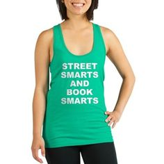 Women's dark color teal green racerback tank top with Street Smarts And Book Smarts theme. In most cases the average person either has street smarts or book smarts. When someone has both they have an advantage in society. Available in black, navy blue, teal green, poppy red; x-small, small, medium, large for only $22.99. Go to the link to purchase the product and to see other options – http://www.cafepress.com/stsmarts