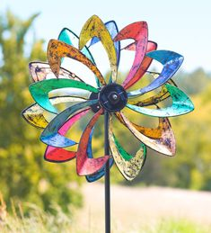 Solar LED Flower Wind Spinner with built-in solar panel - spins and glows for day and night entertainment!