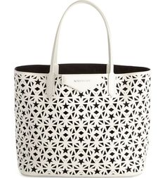 Givenchy's signature star motif makes this perforated leather shopper such a stellar piece.