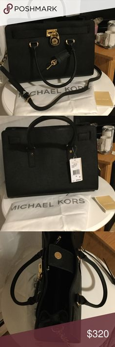 Michael Kors black leather Hamilton satchel Brand new! Comes with care card. Also included is the Michael Kor dust bag. This is a tech friendly handbag. Its especially designed to fit most laptops and tablets. It's padded on the inside. It has gold accessories. The key does unlock the lock.  It's 10in long. 14in side to side. 6in wide. Hand strap is 4 1/2 long. Shoulder strap is 18in high. It has three divided sections. Middle zippers. It also has 5pockets and 1 zipper pocket. Michael Kors…