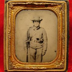 "Confederate 6th Plate Ambrotype, 11th Alabama Vol. Infantry Regiment. Rare Confederate Image with a lot going for it. Note the ""11 ALA"" written in gold tint on his hat. Our subject has a determined look on his face and is armed with a round barreled revolver and 3 band musket. Check out the coarseness of the homespun uniform and the plain as day Confederate Frame Buckle on his belt. We may not know the name of this soldier but there is plenty of information out there on the 11th Alabama…"
