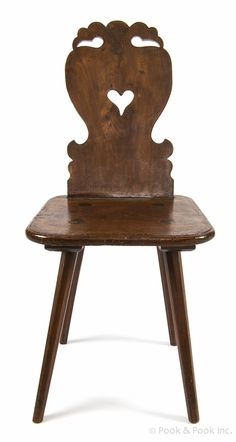 Moravian walnut side chair, 18th c., probably Pennsylvania, with a carved bird head crest above a pierced heart back and plank seat, supported by splayed legs.