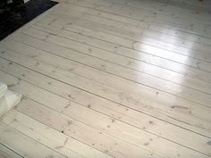 Love this look for our deck: .Pine floor boards, white wash finish - show Geoff, this is too bleached out for us
