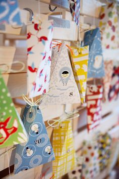 Stunning Advent calendar made with colorful modern papers to form simple packages.