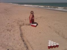 Beer pong on the beach.