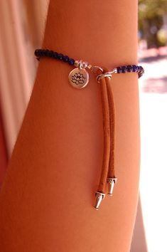 All jewelry is handmade in our studio in Dobbs Ferry, NY. Lotus Flower Blue Lapis Charm Bracelet, Adjustable Bracelet with Trendy Suede Tassel, Natural Blue Lapis Gemstones. Gemstone: Blue Lapis Gemstone Meaning: Universal Meaning of Wisdom and Truth Bead Size: 4mm *(tassel length not included*