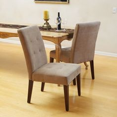 Create an entirely new level of comfort and style to your dining room with this upholstered dining chairs set featuring a warm espresso stained finish. The cream linen fabric is lovely and features an elegant and modern tufted design.
