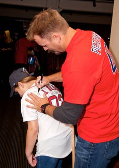 New @Boston Red Sox catcher A.J. Pierzynski signing an autograph at the 2014 New Stars for Young Stars event held in #Boston. @The Jimmy Fund