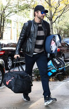 Moving in? Actor Bradley Cooper was spotted carrying a number of bags into girlfriend Irin...