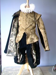Doublet, cape, hose and ruff. Elizabethan finery produced for English Heritage portraying a well to do gentleman of the late 16th century.