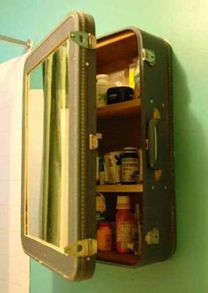 You can DIY this project by adding a mirror to the lid, shelves to the inside and reinforcing the back with wood