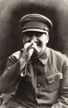 Stalin fooling around while his bodyguard takes a picture.