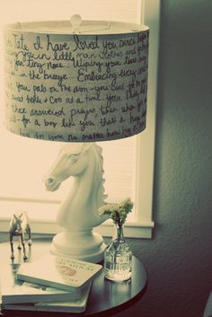 Writing a love letter to your child and  cover an old lamp shade in their room