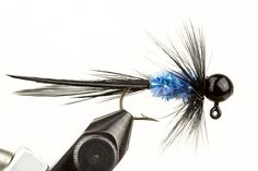 Bugz Black & Blue Jig - Jigs are becoming more and more popular in the fly fishing community. The Bugz jigs are designed for ice fishing for panfish. However, they have been know the land numerous other species including both trout and steelhead! Black with Blue Sparkle Chenille. Hand Tied by our friends at Haggerty Lures. Made in the USA! Please note size refers to the hook size and weight refers to the jig head weight.