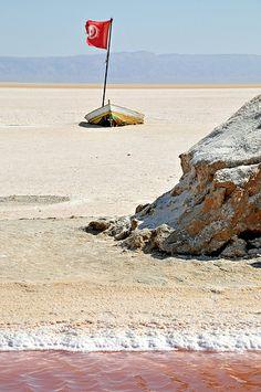 boat dried out on Chott el Jerid, a seasonal crystalline (salt) lake