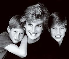 Royal Family Christmas Card (1995) | The single mom and her sons flashed beautiful smiles for another black-and-white portrait. It would be the last Christmas card in which Princess Diana would feature.