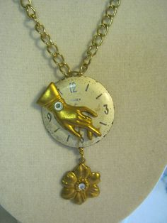 Steampunk Watch Face Hand With Flower Charm Necklace. $30.50, via Etsy.