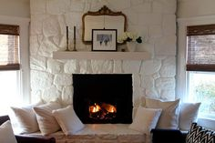 Featured on Design Sponge - Most-Lovely-Things-White-Painted-Stone-Fireplace - Decor, White Paint Colors, Stone Fireplace Makeover, Home Decor, Painted Stone Fireplace, Fireplace Decor, Painted Brick, Fireplace, Painted Rock Fireplaces