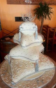 Bling - 4Tier Pillow Wedding cake. W edding at Lyon Des Sables Restaurant in Walvis Bay.    Probst Willi Bakery, Restaurant, Boulevard Cafe and Coffee Shop.