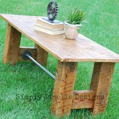 Barn wood coffee table. I like the design of the legs & addition of steel pipe.