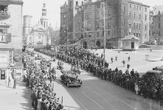 Photograph of the Royal car on a crowd-lined street in Québec City, 1939.