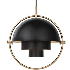 Gubi Multi-Lite, designed by Louis Weisdorf in 1972, is an elegant pendant light that plays with geometric shapes. As its name suggests, the pendant has multiple uses and configurations: by rotating the two shades around the cylindrical middle light can be cast up, down and to the sides.