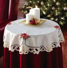 "Holiday Christmas Candle Decorative Table Linen Topper By Collections Etc by Collections. $10.99. Wintertime greenery and festive holiday candle stitchwork. Bring classic holiday elegance to any table top. Fits most end tables, dressers and vanities. Vintage-look topper features flowing cutwork and detailed embroidery. Polyester. Measures 35""Dia.. Give any table a beautiful lace-trimmed topper, embroidered with wintertime greenery and festive holiday candles. Stunning on an end t..."