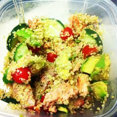 Quinoa salad with salmon, cucumbers, tomatoes, avocado, cilantro, and a fresh squeeze of lemon and lime.