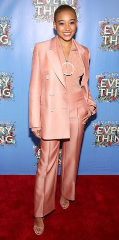 Amandla Stenberg made the case for Millennial pink in this glam ensemble: a satin suit with glitter button detailing styled to perfection with a glimmering knit top and strappy sandals.