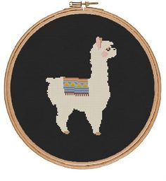 A wonderfully simple and sweet pattern. This lovely llama cross stitch pattern uses several coloured threads (see the end picture) but you could use any colours that fit your style. Instant PDF download. Try stitching it on black cloth for added drama (see second picture). This pattern uses basic cross stitch and is suitable for beginners . If you need any help with how to follow the pattern, just get in touch. This is a downloadable PDF cross stitch pattern. Once you order you can down load…