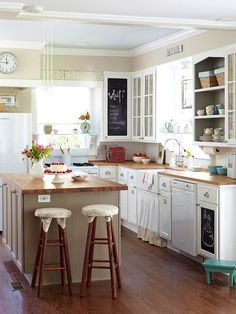 whoa!  chalkboard on two cabinets!  and love the white!