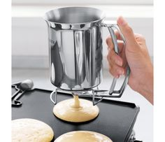 Take your breakfast game to a whole new level by serving up some restaurant styled flapjacks using the pancake batter dispenser. Made out of durable stainless steel, this device perfectly dispenses the batter without creating a mess in the kitchen. Cool Kitchen Gadgets, Smart Kitchen, Kitchen Items, Kitchen Utensils, Cool Gadgets, Kitchen Tools, Cool Kitchens, Kitchen Appliances, Kitchen Stuff
