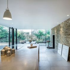 The group of architects from the Jonathan Tuckey Design studio has made a unique glazed look to the Grade II-listed Yew Tree House. The past owners of the house used. House Design, House, Stone Cottage, House Extensions, Glass Extension, Cotswold House, Cottage Renovation, New Homes, Renovations