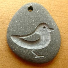 bird carved pebble pendant by birdahoy on Etsy