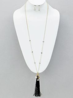 Black Tassel and Crystal Gold Chain Long Necklace Long gold chain with black crystal beads along the chain with a black tassel and charms. Necklace measures 3