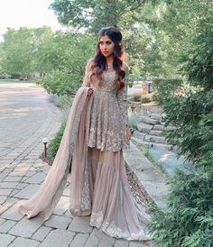 Pale Pink Silver Embroidered Pakistani Style Peplum Sharara Set - Source by - Asian Bridal Dresses, Desi Wedding Dresses, Indian Gowns Dresses, Indian Fashion Dresses, Bridal Outfits, Indian Outfits, Asian Bridesmaid Dresses, Pakistani Clothing, Shadi Dresses