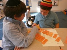 Students work on learning common grammatical structures and vocabulary in Torah