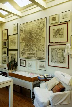 Framed maps will do it every time, especially those with a hand-drawn, vintage feel, whether in color paper type or illustration style.