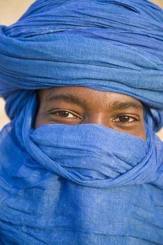 Mali, Timbuktu. The eyes of a Tuareg man in his blue turban at Timbuktu.