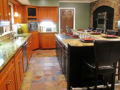 """L-shaped, raised eating counter -- with the stove on the island!!  Look, hubby: your favorite!! Featured in Kitchen Impossible episode """"22 Year Facelift""""  Find air times for this episode or watch Kitchen Impossible online"""