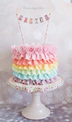 A pastel rainbow ruffle cake on the outside and rainbow sponge on the inside for Sophie's birthday. This has some of my favourite things on a cake…pastel's and bunting! It was suprisingly quick to make too…plus Sophie loved it! Pretty Cakes, Cute Cakes, Pastell Party, Heart Cakes, Cute Birthday Cakes, Birthday Ideas, Tsumtsum, Gateaux Cake, Butterfly Cakes