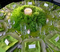A large votive candle was placed in the middle grass like centerpiece. You can use grass or any other craft.