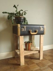 Reclaimed pallet and repurposed suitcase side table